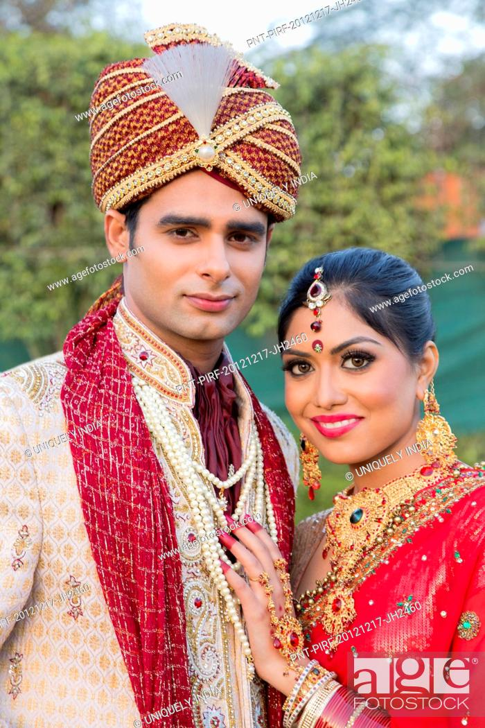 af605f96c9 Indian bride and groom in traditional wedding dress, Stock Photo ...