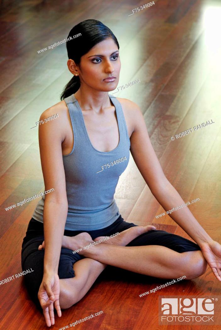 Stock Photo: Indian girl doing yoga.