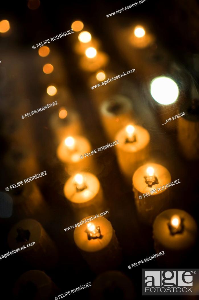 Stock Photo: Electric votive candles, Seville, Spain.