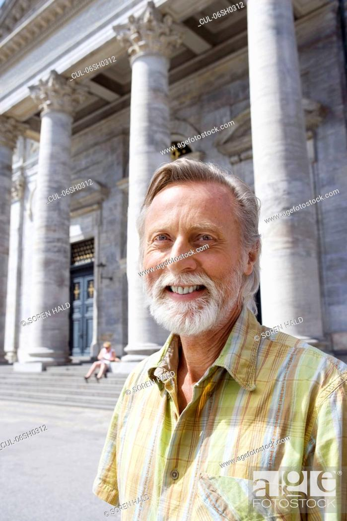 Stock Photo: Portrait of man in front of church.