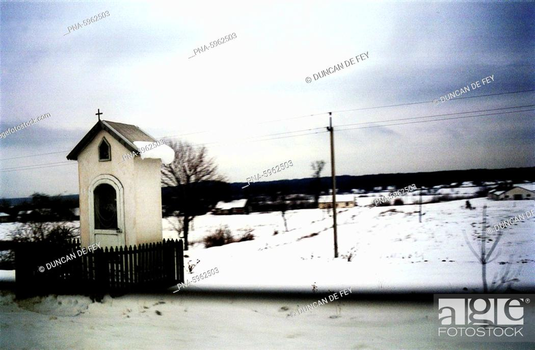 Stock Photo: Small roadside chapel in the Ukraine in winter.
