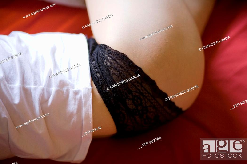 Stock Photo: Plan view of the hip of a woman lying in bed.