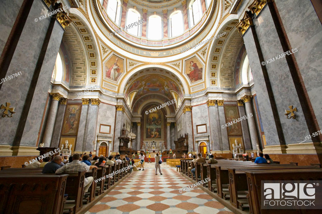 Stock Photo: HUNGARY   Esztergoms basilica is the largest church in Hungary, interior view down aisle of sanctuary, rows of pews.
