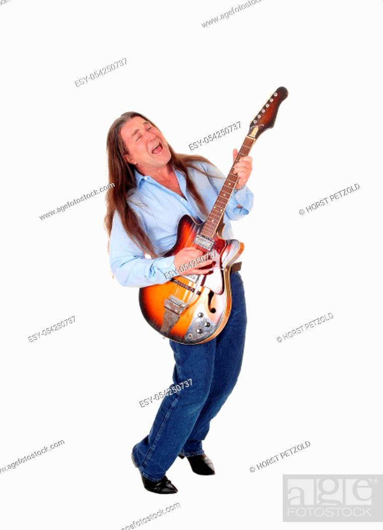 Stock Photo: A happy musician playing his guitar with his long brunette.hair, singing, isolated for white background.