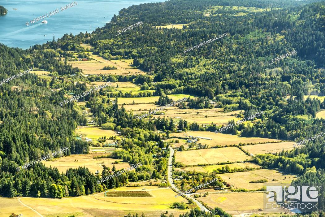 Stock Photo: Canada, BC, Saltspring Island. View of farms in the Fulford Valley from Mount Maxwell.