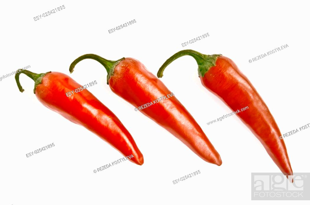Stock Photo: Three red hot peppers isolated on white background.