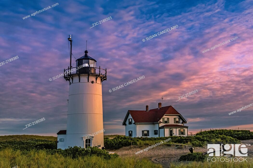 Stock Photo: Race Point Lighthouse during sunset. Race Point is a historic lighthouse and it is located in the northern tip of Cape Cod, Massachusetts.