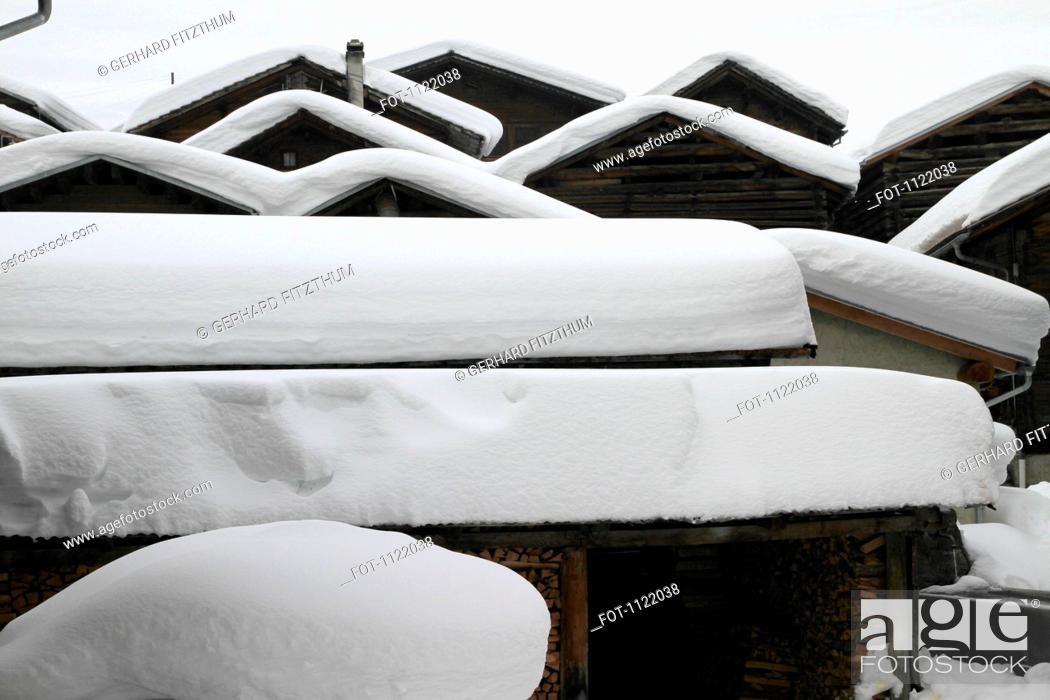 Stock Photo: Patterns of snow-capped cabins.