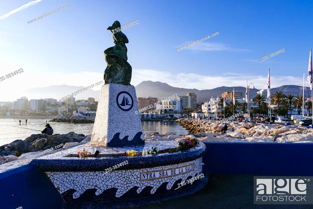 Stock Photo: Monument to the Virgin. Our Lady of Health - Nuestra señora de la Salud. Puerto Marina in the tourist seaside town of Benalmádena, Málaga, Costa del Sol.