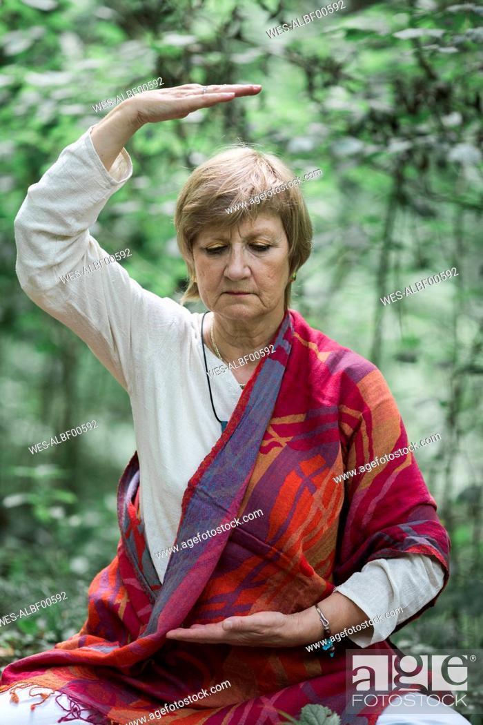 Stock Photo: Senior woman doing yoga, meditating.
