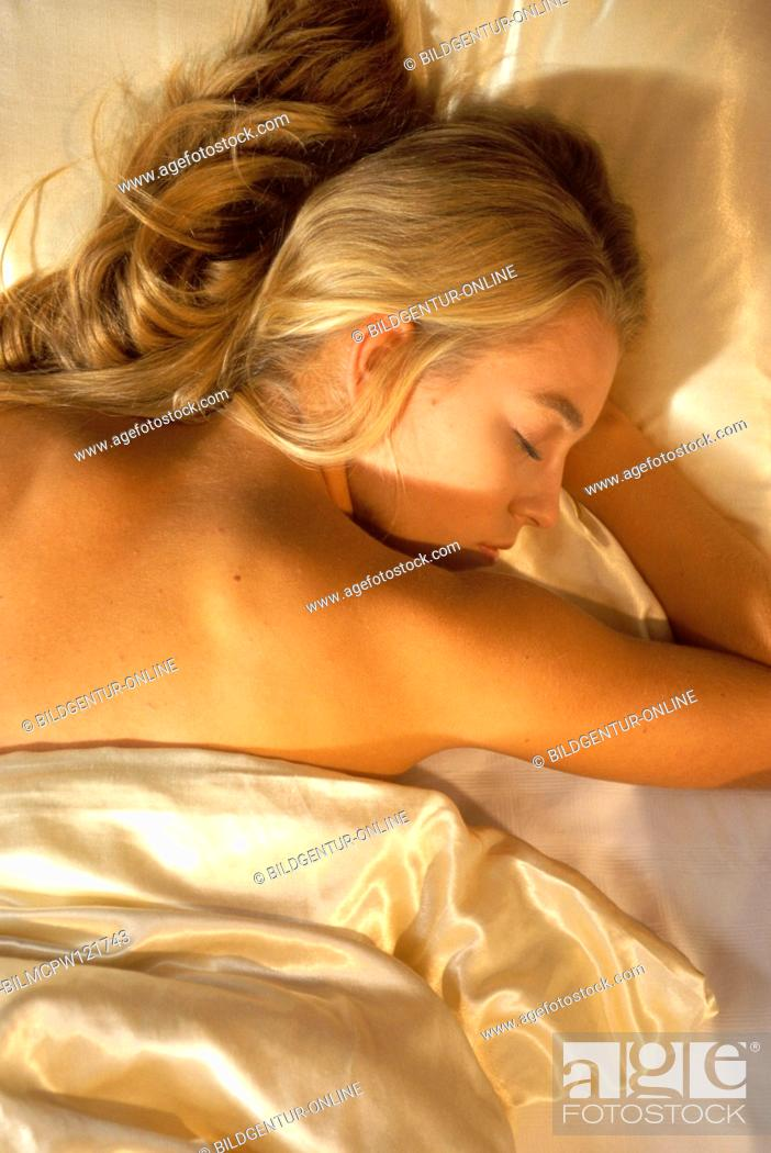 Stock Photo: Young woman sleeping in the bed.