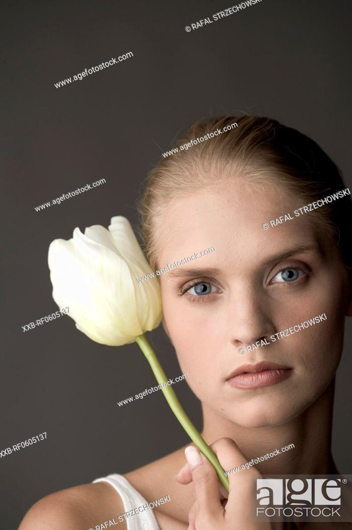 Stock Photo: young woman with tulip.