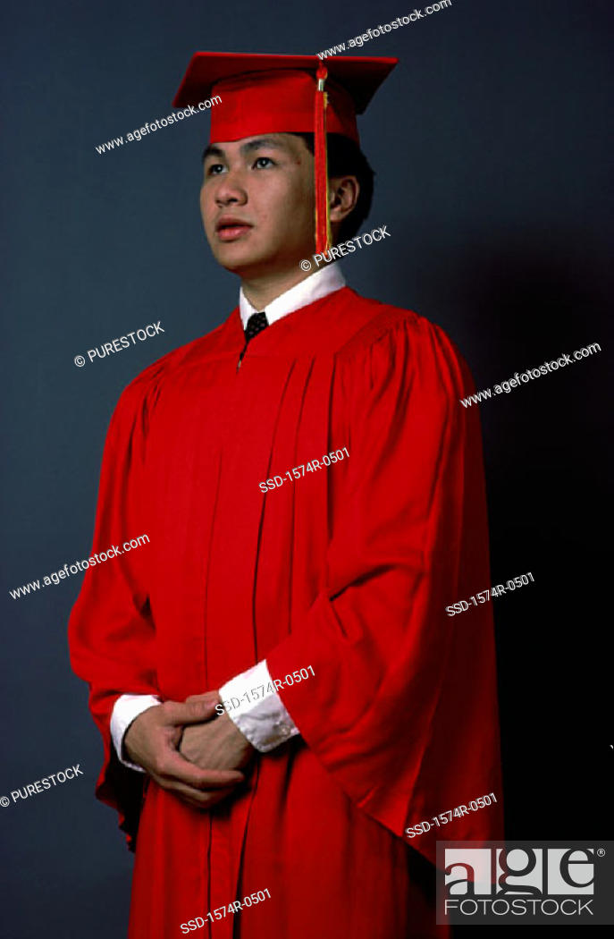 Stock Photo: Young man wearing a graduation outfit.