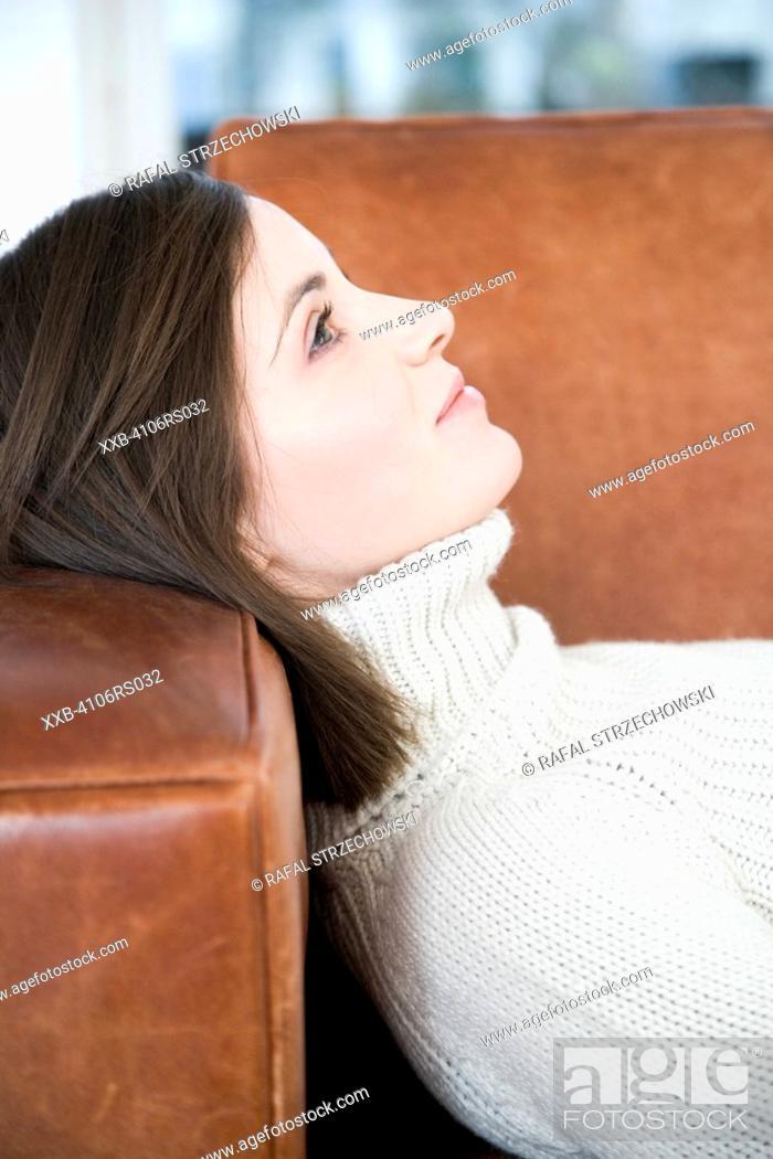 Stock Photo: woman lying on sofa.