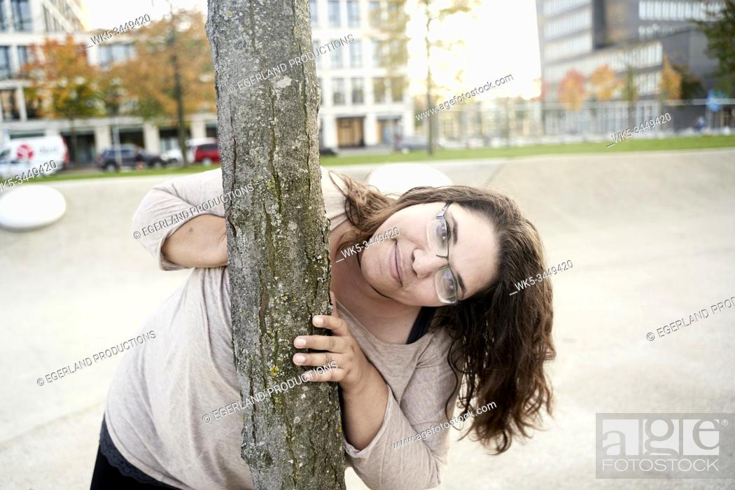 Stock Photo: woman at tree in park.