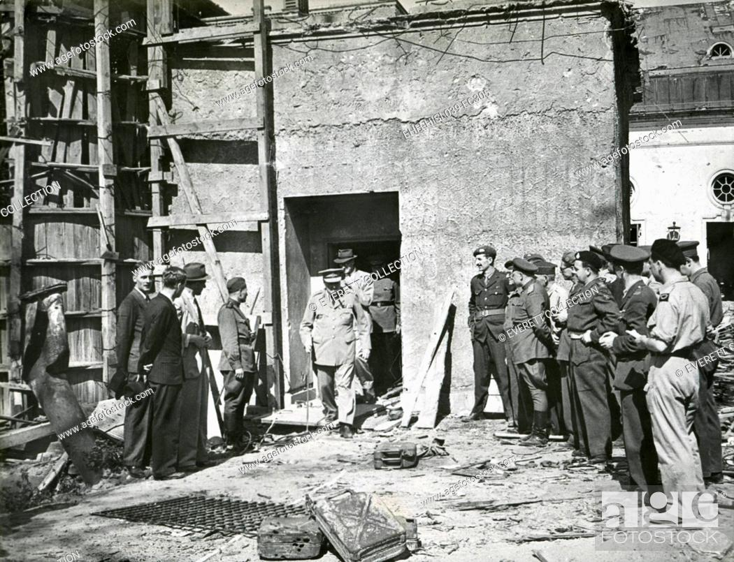 Stock Photo: Premier Winston Church emerging from the Reich Chancellery, March 20, 1945. This was the underground Berlin bunker in which Hitler and Eva Braun committed.