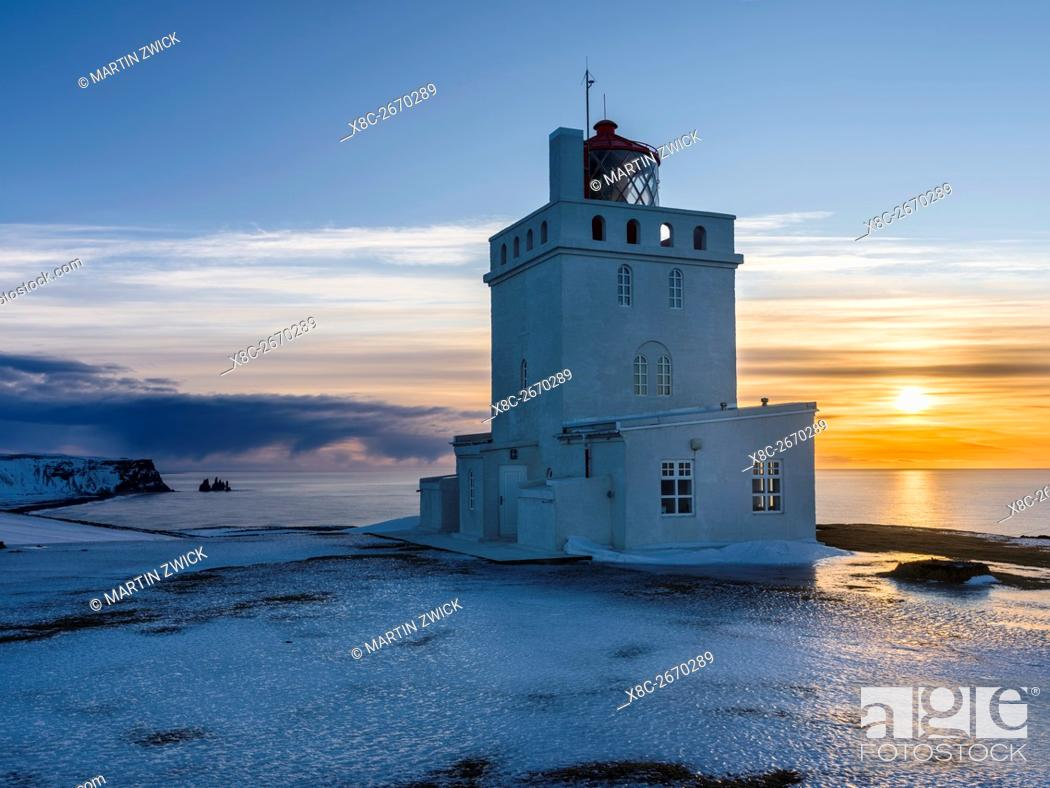 Stock Photo: The lighthouse at cape Dyrholaey. Coast of the North Atlantic near Vik y Myrdal during winter. europe, northern europe, scandinavia, iceland, February.