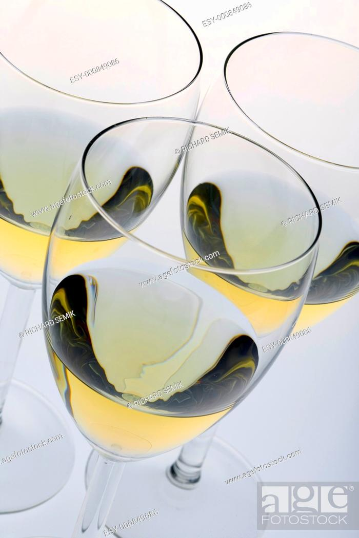 Stock Photo: wineglasses with white wine.