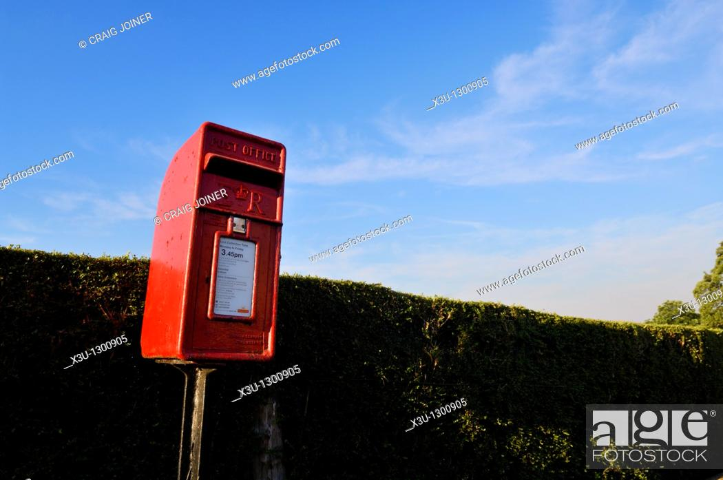 Stock Photo: Traditional red post box at the village of Redhill, Somerset England, United Kingdom.