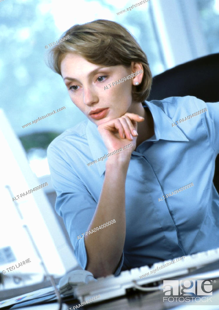Stock Photo: Businesswoman looking at computer.
