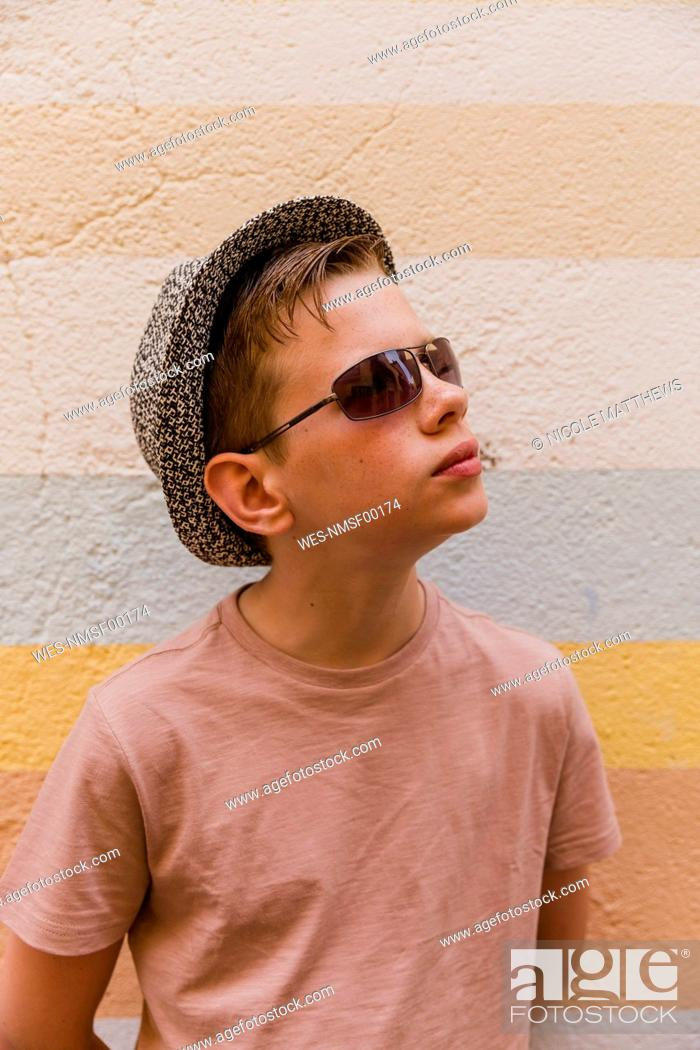 Stock Photo: Portrait of boy wearing sunglasses and hat.
