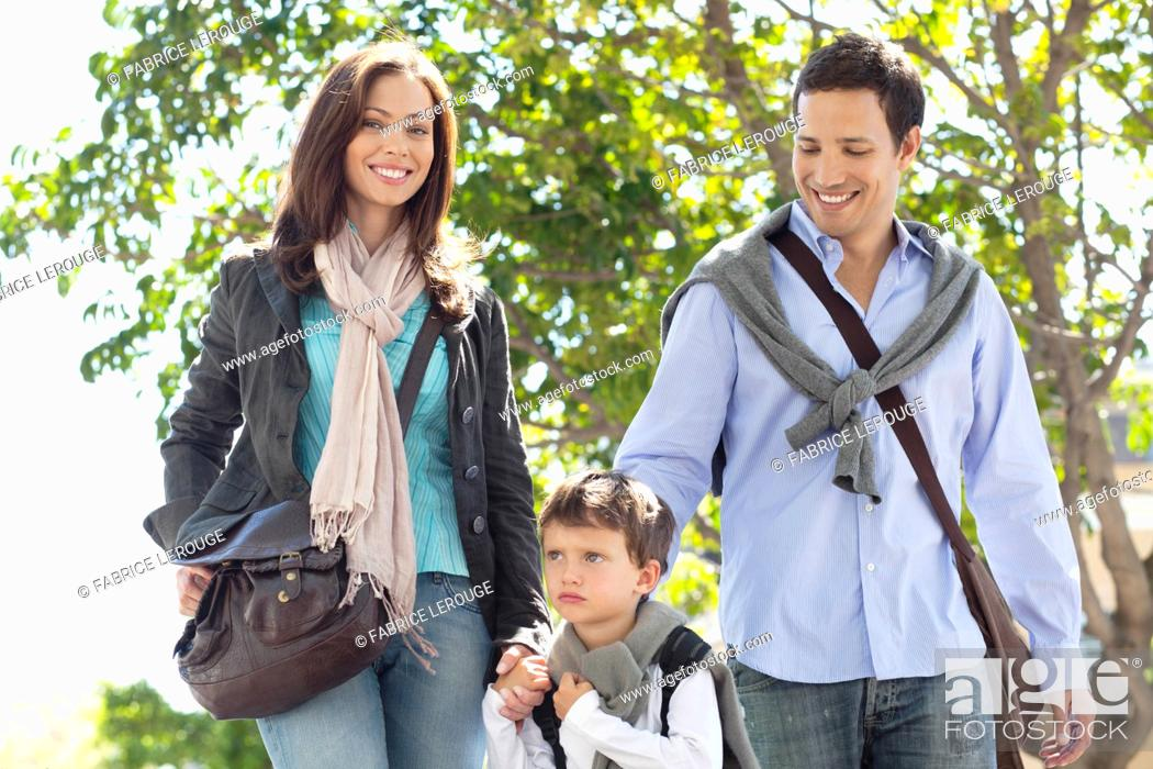 Stock Photo: Family walking together on the road.