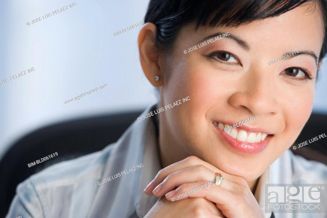 Stock Photo: Portrait of Asian businesswoman.