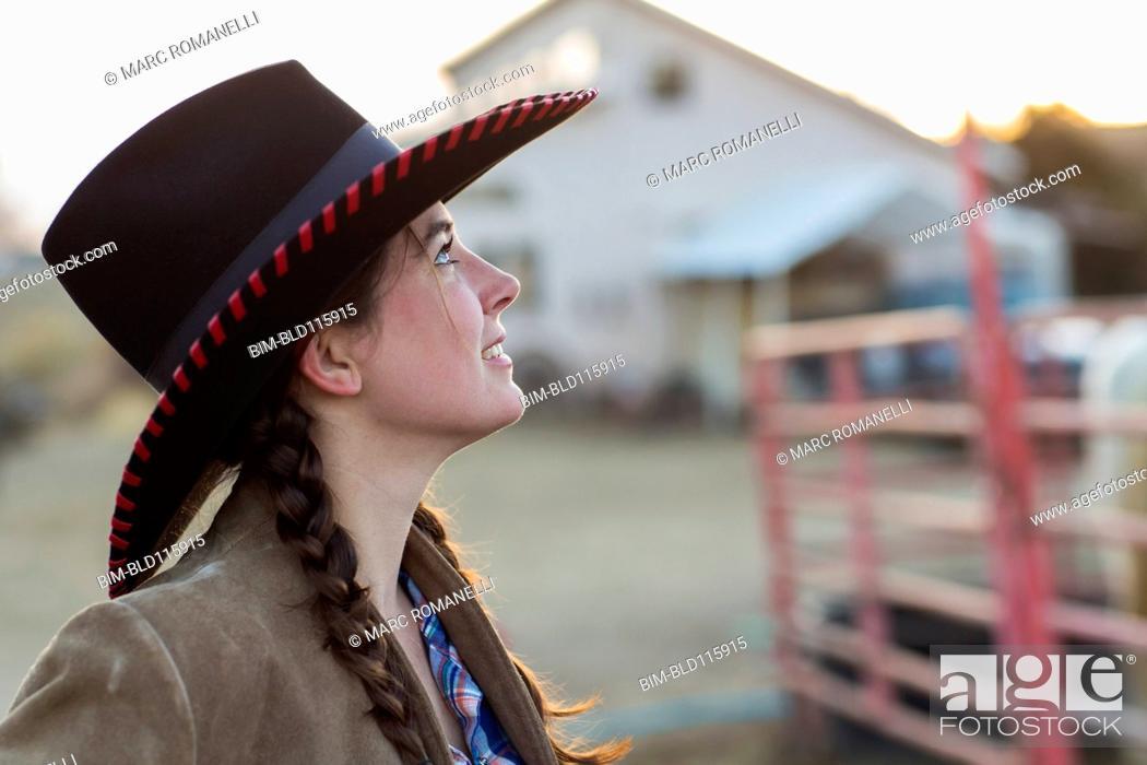 Stock Photo: Caucasian girl smiling on farm.