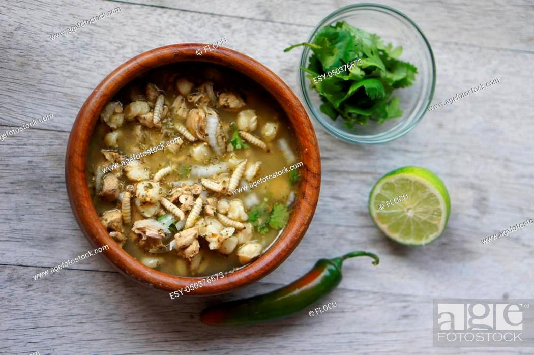 Stock Photo: Pozole (Hominy), cilantro (coriander), jalapeno peppers, onions, tomatillo, lime, and pork with wax moth larvae.