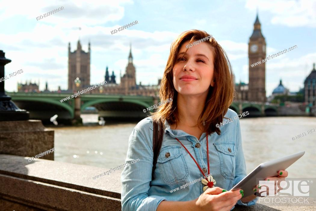 Stock Photo: Young woman using a digital tablet in London.