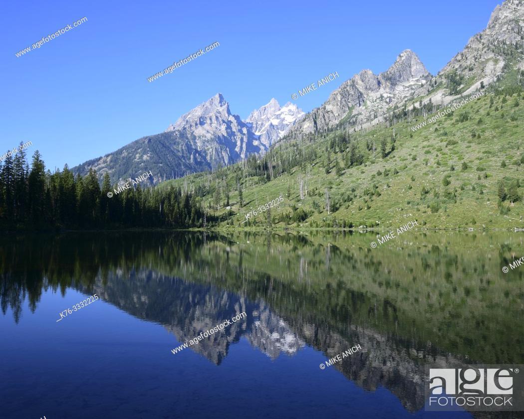 Stock Photo: Grand Tetons, reflected in String Lake, National Park, Wyoming.