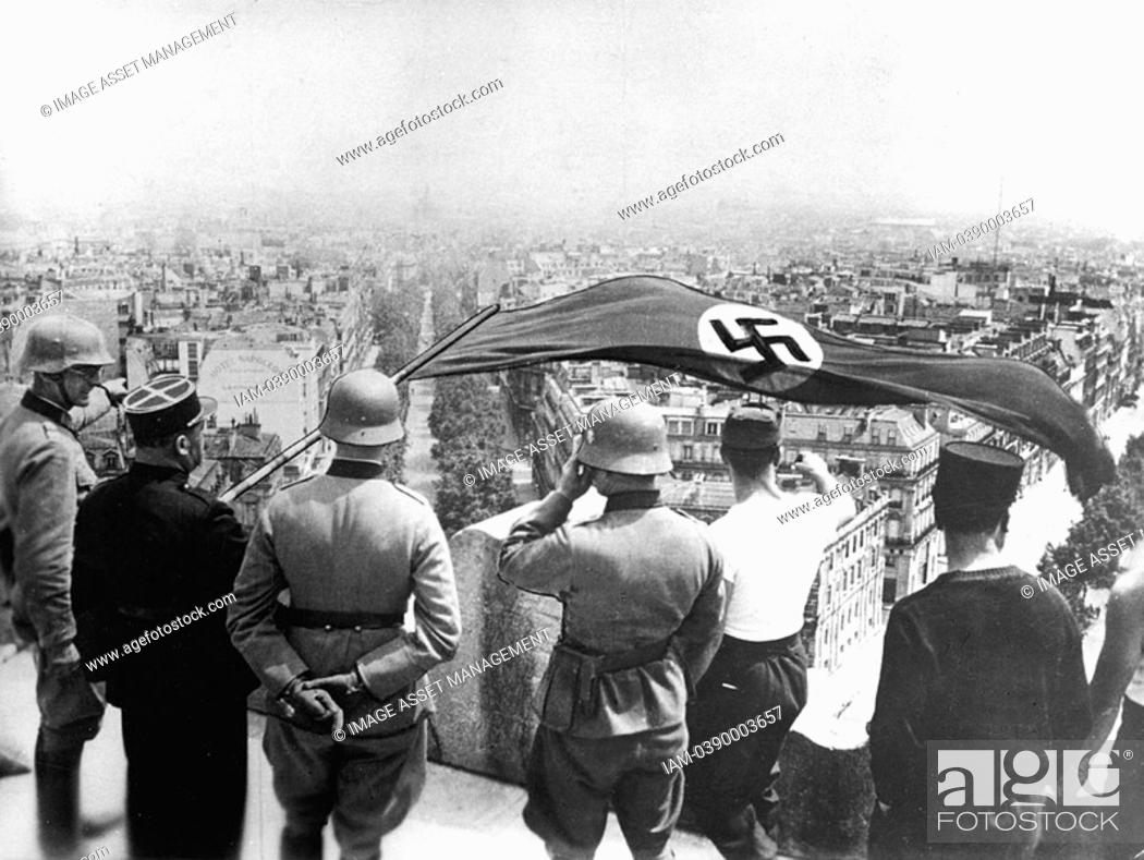 Stock Photo: World War 2:German occupation of Paris, June 1940  The German flag flying from the Arc de Triomphe.