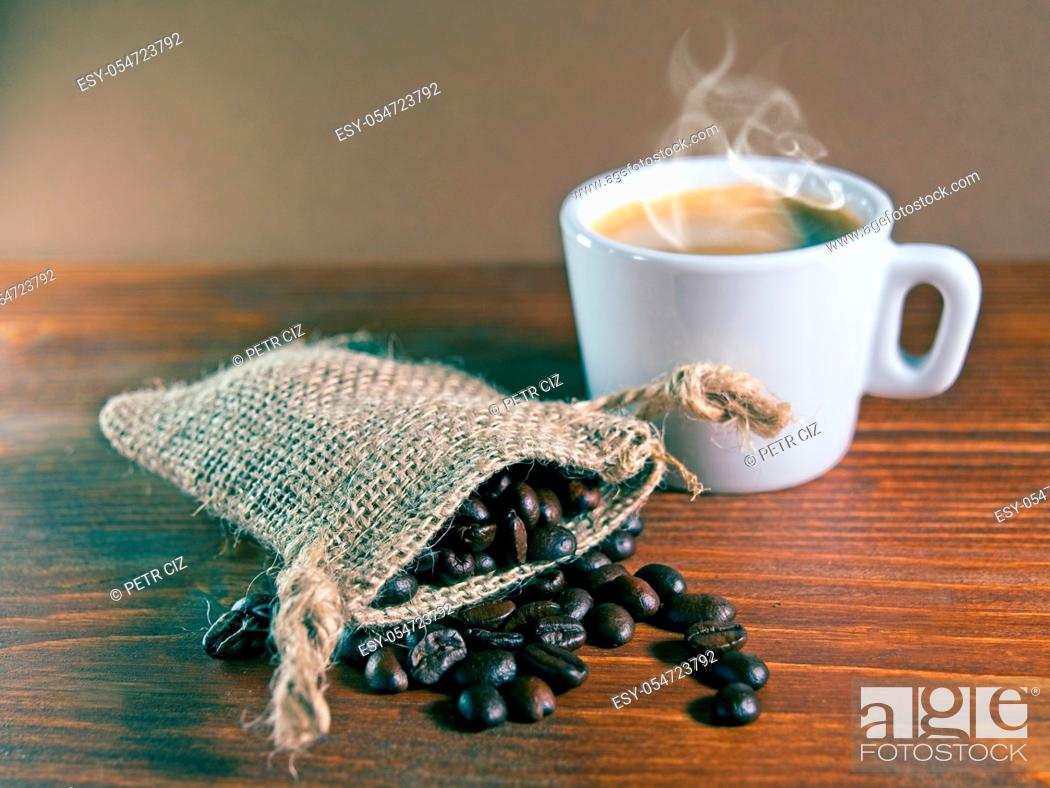 Stock Photo: Espresso Coffee Cup with jute sack of roasted coffee beans.