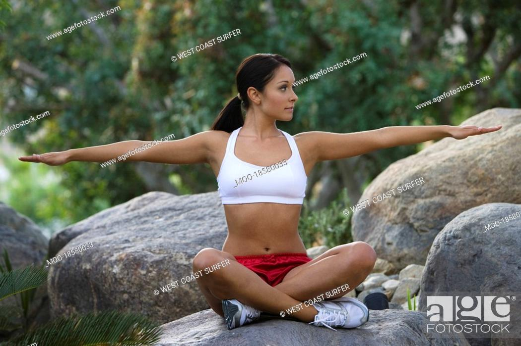 Stock Photo: Woman exercising in park.