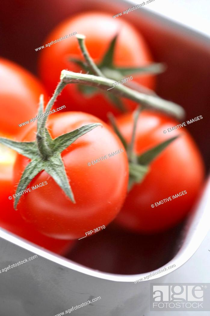 Stock Photo: Tomatos in a metall box.