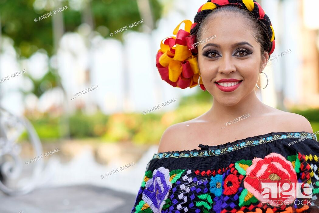 Stock Photo: Young woman wearing traditional Mexican costume while smiling at camera. Puerto Vallarta, Jalisco, Mexico.