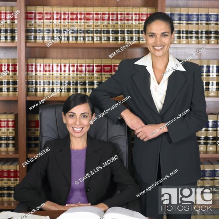 Stock Photo: Hispanic female lawyers in office.