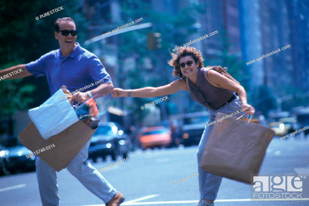 Stock Photo: Young couple with shopping bags.