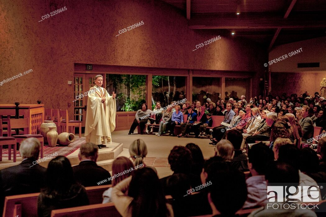 Stock Photo: A pastor preaches a sermon to his congregation while conducting mass at St. Timothy's Catholic Church, Laguna Niguel, CA.