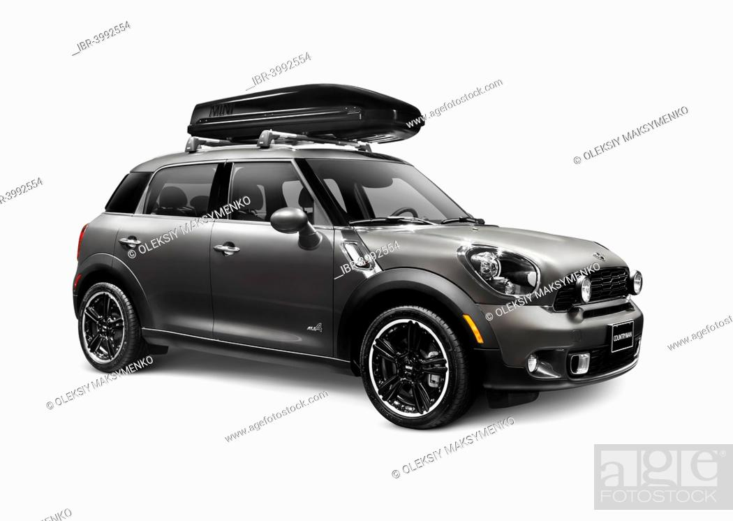 Stock Photo: Gray 2014 Mini Cooper Countryman compact CUV car with a cargo roof box.