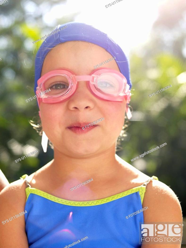 Stock Photo: Girl wearing swimming goggles and cap portrait.