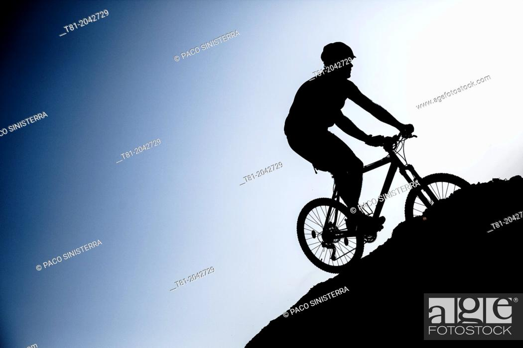Stock Photo: Silhouette biking btt decline in the Sierra de Cazorla, Andalucia, Spain.