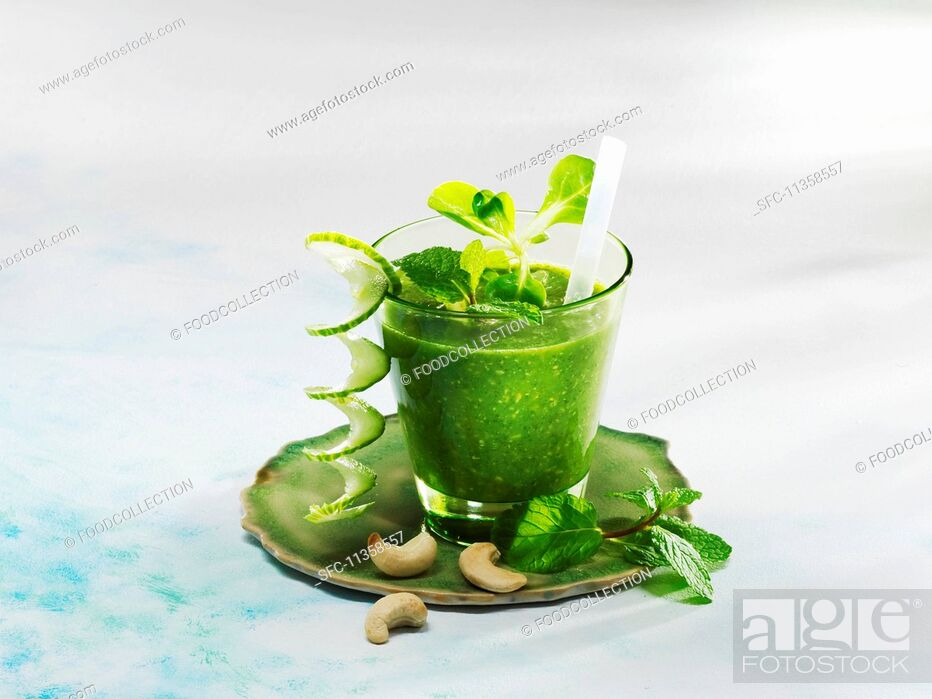 Stock Photo: A cucumber and mint smoothies with lamb's lettuce and cashew nuts.