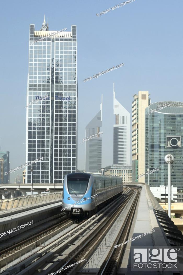 Stock Photo: Dusit Thani Dubai. Dubai Metro. The first two lines run underground in the city centre and on elevated viaducts elsewhere (elevated railway).
