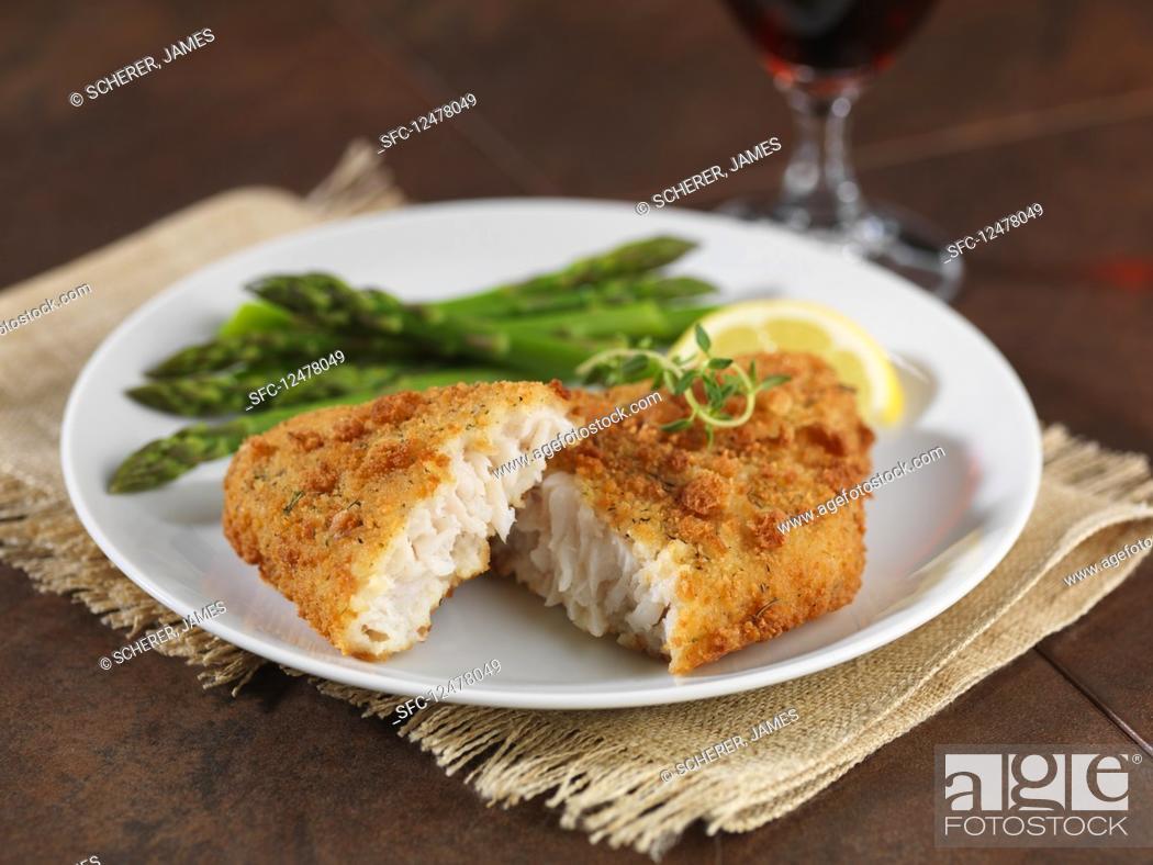 Photo de stock: Breaded Alaska pollock with green asparagus.