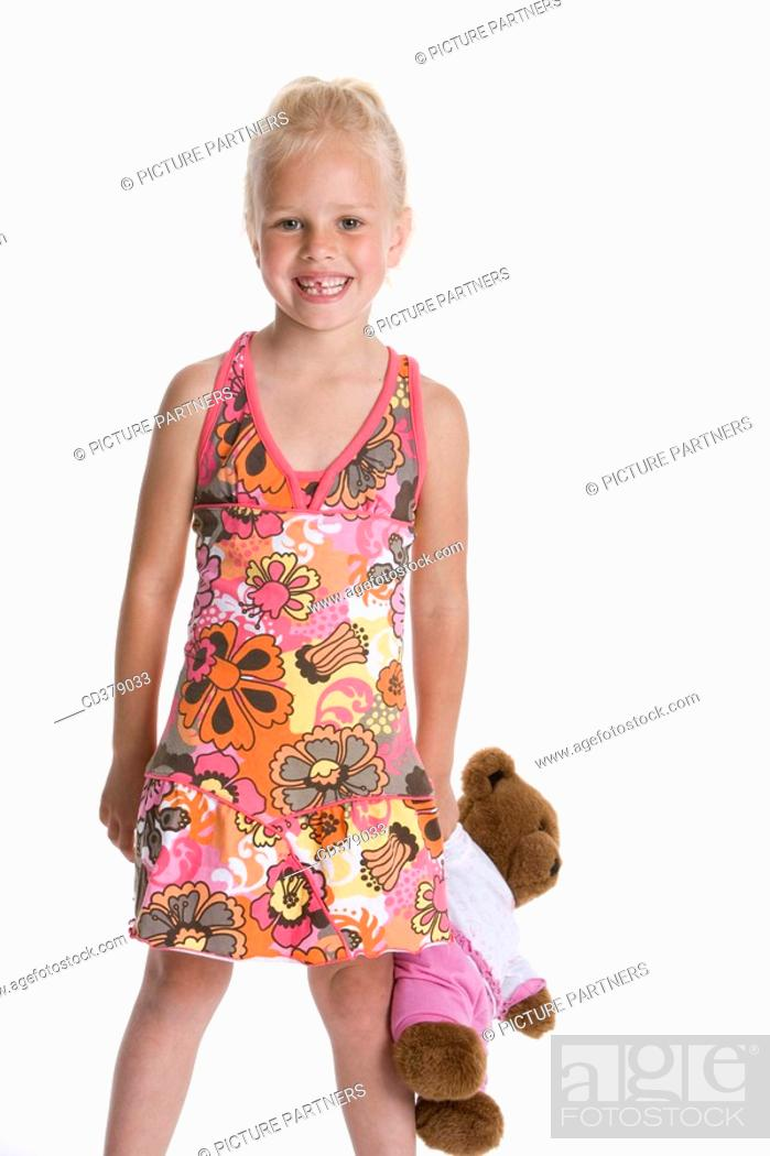 Stock Photo: Portrait of a blond girl with her toy bear.