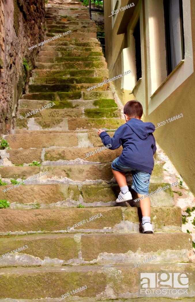 Stock Photo: Child climbing stairs, Pasai Donibane, Pasajes de San Juan, Gipuzkoa, Basque Country, Spain.
