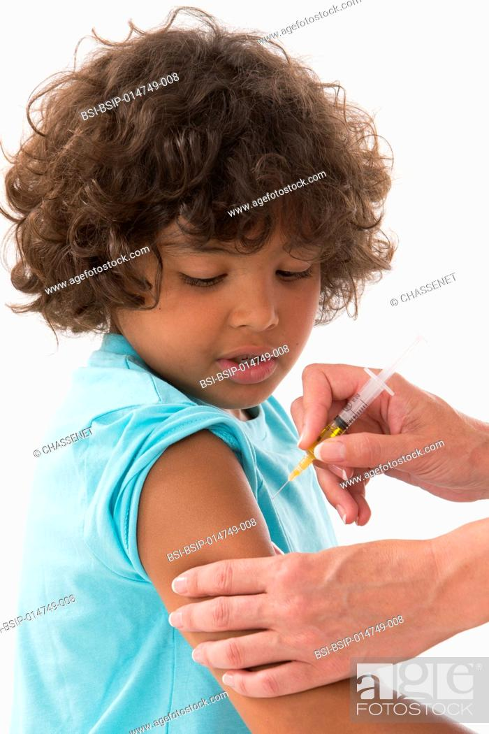 Stock Photo: Vaccinating a boy.