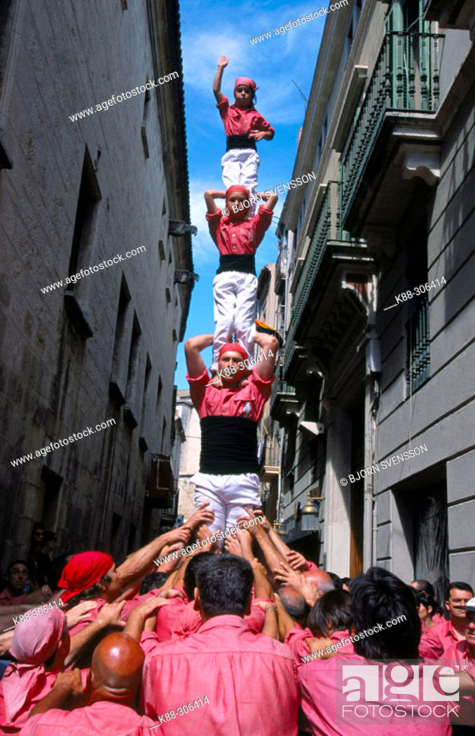 Stock Photo: 'Castellers' building human towers, a Catalan tradition. Vilafranca del Penedès. Barcelona province, Spain.