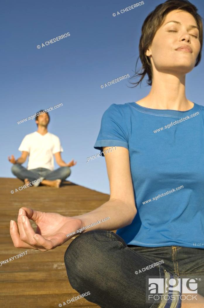 Stock Photo: Couple in yoga attitude, outdoors.